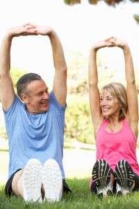 Older couple stretching together